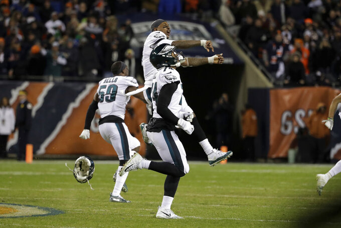 Philadelphia Eagles players celebrate after Chicago Bears kicker Cody Parkey misses a field goal in the final minute during the second half of an NFL wild-card playoff football game Sunday, Jan. 6, 2019, in Chicago. The Eagles won 16-15. (AP Photo/Nam Y. Huh)