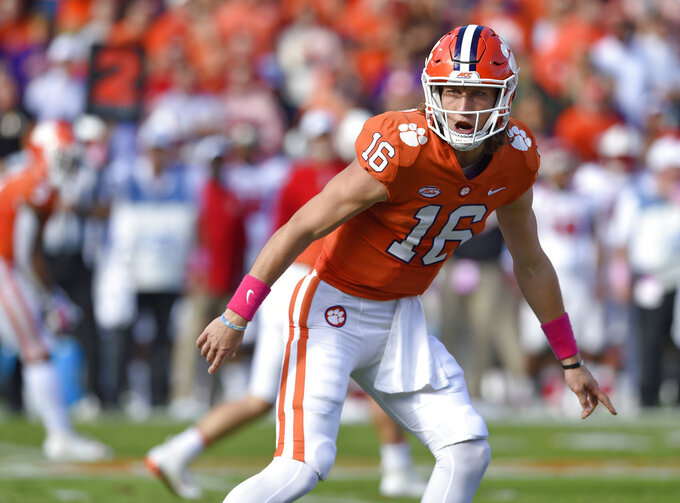 Clemson quarterback Trevor Lawrence calls a play during the first half of an NCAA college football game against North Carolina State, Saturday, Oct. 20, 2018, in Clemson, S.C. (AP Photo/Richard Shiro)