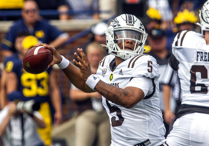 Western Michigan quarterback Kaleb Eleby (5) throws a pass in the first quarter of an NCAA college football game against Michigan in Ann Arbor, Mich., Saturday, Sept. 4, 2021. (AP Photo/Tony Ding)