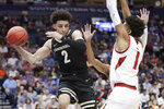 Vanderbilt's Scotty Pippen Jr. (2) drives against Arkansas guard Isaiah Joe (1) in the first half of an NCAA college basketball game in the Southeastern Conference Tournament Wednesday, March 11, 2020, in Nashville, Tenn. (AP Photo/Mark Humphrey)