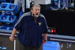 West Virginia head coach Bob Huggins shouts during the first half of a second-round game against Syracuse in the NCAA men's college basketball tournament at Bankers Life Fieldhouse, Sunday, March 21, 2021, in Indianapolis. (AP Photo/Darron Cummings)