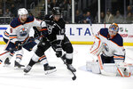 Edmonton Oilers goaltender Mikko Koskinen, right, of Finland, stops a shot by Los Angeles Kings center Anze Kopitar, center, of Slovenia, with defenseman Adam Larsson, left, of Sweden, helping Koskinen during the second period of an NHL hockey game in Los Angeles, Thursday, Nov. 21, 2019. (AP Photo/Alex Gallardo)