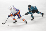 New York Islanders center Anders Lee (27) skates in front of San Jose Sharks center Antti Suomela (40) during the third period of an NHL hockey game in San Jose, Calif., Saturday, Nov. 23, 2019. (AP Photo/Jeff Chiu)