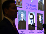 Attorney Kevin Quinn is silhouetted as he addresses the media about separate lawsuits his firm filed Wednesday, August 27, 2019 against The Diocese of Scranton, Bishop Joseph Bambera and former Bishop James Timlin, at a press conference held at the Hilton in Scranton, Pa., Wednesday August 28, 2019. (Aimee Dilger/The Times Leader via AP)