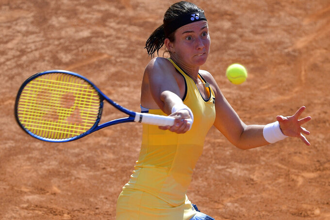 Latvia's Anastasija Sevastova returns the ball to Italy's Jasmine Paolini during their match at the Italian Open tennis tournament, in Rome, Monday, Sept. 14, 2020. (Alfredo Falcone/LaPresse via AP)