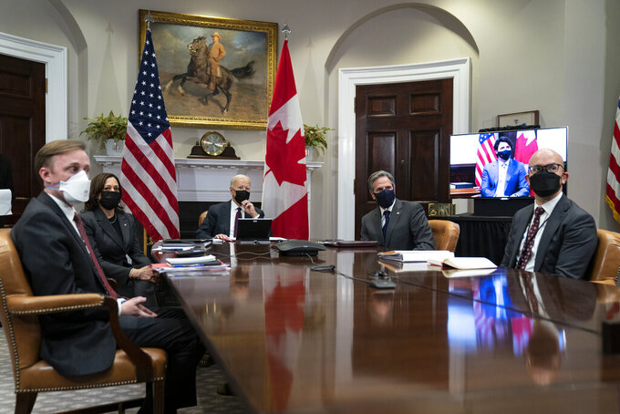 President Joe Biden holds a virtual bilateral meeting with Canadian Prime Minister Justin Trudeau, in the Roosevelt Room of the White House, Tuesday, Feb. 23, 2021, in Washington. From left, White House national security adviser Jake Sullivan, Vice President Kamala Harris, Biden, Secretary of State Antony Blinken, and National Security Council senior director for the Western Hemisphere Juan Gonzalez. (AP Photo/Evan Vucci)