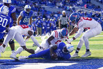 Kentucky quarterback Terry Wilson (3) scores a touchdown during the first half of an NCAA college football game against Mississippi, Saturday, Oct. 3, 2020, in Lexington, Ky. (AP Photo/Bryan Woolston)