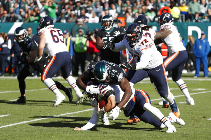 Chicago Bears' Mitchell Trubisky (10) is tackled by Philadelphia Eagles' Josh Sweat (94) during the first half of an NFL football game, Sunday, Nov. 3, 2019, in Philadelphia. (AP Photo/Chris Szagola)