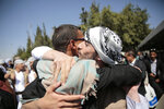 A Yemeni prisoner is greeted by his relative after being released by the Saudi-led coalition, at the airport in Sanaa, Yemen, Thursday, Oct. 15, 2020. (AP Photo/Hani Mohammed)