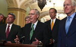 Senate Majority Leader Mitch McConnell of Ky., center, speaks to reporters on Capitol Hill in Washington, Tuesday, Feb. 13, 2018, following the weekly Republican policy luncheon. McConnell is joined by, from left, Sen. Cory Gardner, R-Colo., Sen. Roy Blunt, R-Mo., Sen John Thune, R-S.D., and Sen. John Cornyn, R-Texas. (AP Photo/Susan Walsh)