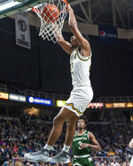 In this Jan. 27, 2019 photo provided by Siena College, Siena point guard Jalen Pickett dunks during Siena's NCAA college basketball game against Manhattan at Siena College in Loudonville, N.Y. Pickett, who averages 15.5 points and leads the MAAC with 6.4 assists per game, has helped lead Siena into contention for the Metro Atlantic Athletic Conference regular-season title. (Rob Simmons/Siena College via AP)