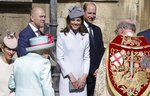 Members of Britain's Royal family watch as Britain's Queen Elizabeth II arrives to attend the Easter Mattins Service at St. George's Chapel, at Windsor Castle in England Sunday, April 21, 2019. (AP Photo/Kirsty Wigglesworth, pool)
