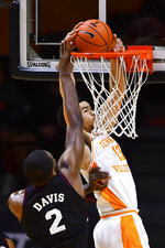 Tennessee forward Olivier Nkamhoua (13) dunks next to Mississippi State's Javian Davis (2) during an NCAA college basketball game Tuesday, Jan. 26, 2021, in Knoxville, Tenn. (Brianna Paciorka/Knoxville News Sentinel via AP, Pool)