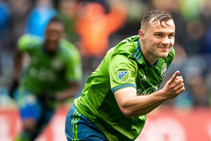 Seattle Sounders forward Jordan Morris (13) celebrates his goal during the first half of round one of an MLS Cup playoff soccer game against FC Dallas, Saturday, Oct. 19, 2019 in Seattle.  (Andy Bao/The Seattle Times via AP)