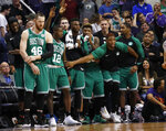 Players on the Boston Celtics bench celebrate as time expires in the second half of the team's NBA basketball game against the Phoenix Suns, Thursday, Nov. 8, 2018, in Phoenix. The Celtics won 116-109 in overtime. (AP Photo/Matt York)
