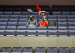 A few fans watch Virginia play St. Francis during an NCAA college basketball game Tuesday, Dec. 1, 2020, in Charlottesville, Va. (Andrew Shurtleff/The Daily Progress via AP)