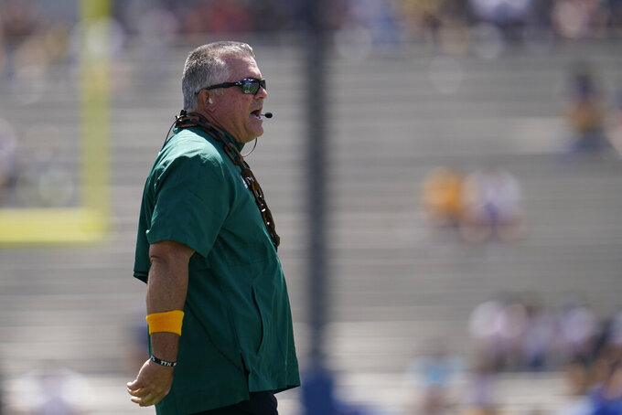 Hawaii head coach Todd Graham yells from the sideline during the first half of an NCAA college football game against UCLA Saturday, Aug. 28, 2021, in Pasadena, Calif. (AP Photo/Ashley Landis)