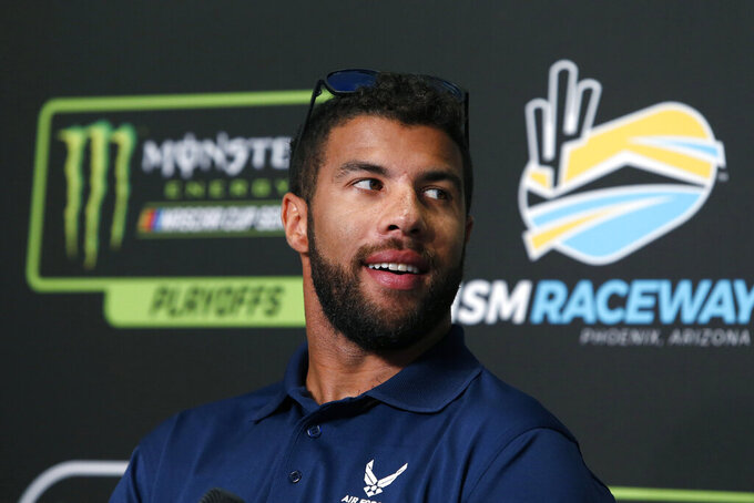 Bubba Wallace at a pre-race press conference during the NASCAR Cup Series auto race at ISM Raceway, Sunday, Nov. 10, 2019, in Avondale, Ariz. (AP Photo/Ralph Freso)