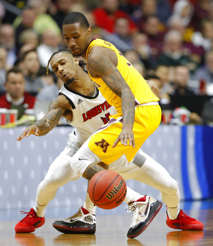 Minnesota guard Dupree McBrayer is fouled by Louisville guard Khwan Fore, left, during a first round men's college basketball game in the NCAA Tournament, Thursday, March 21, 2019, in Des Moines, Iowa. Minnesota won 86-76. (AP Photo/Charlie Neibergall)