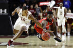 Temple's Nate Pierre-Louis, left, and Houston's Corey Davis Jr. chase after a loose ball during the second half of an NCAA college basketball game, Wednesday, Jan. 9, 2019, in Philadelphia. Temple won 73-69. (AP Photo/Matt Slocum)