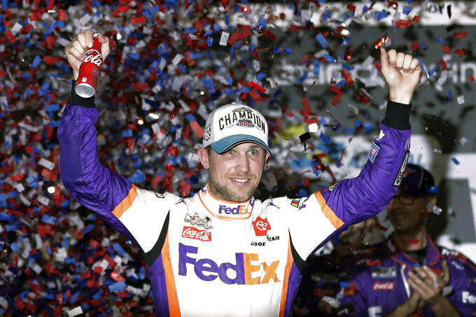 FILE - In this Feb. 17, 2020, file photo, driver Denny Hamlin celebrates in Victory Lane after winning the NASCAR Daytona 500 auto race at Daytona International Speedway in Daytona Beach, Fla. Hamlin closed NASCAR's iRacing Series virtual auto race with a victory at a simulation of throwback North Wilkesboro Speedway on Saturday, May 9, 2020.  (AP Photo/John Raoux)