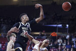 Wake Forest forward Ody Oguama (33) loses control of a rebound against Boston College during the first half of an NCAA college basketball game in Boston, Wednesday, Nov. 6, 2019. (AP Photo/Charles Krupa)