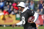 Baltimore Ravens quarterback Lamar Jackson runs with the ball during a practice for NFL Pro Bowl football game Wednesday, Jan. 22, 2020, in Kissimmee, Fla. (AP Photo/John Raoux)