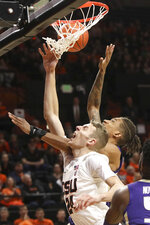 Oregon State's Kylor Kelley (24) and Washington's Nate Roberts (13) fight for a rebound during the first half of an NCAA college basketball game in Corvallis, Ore., Saturday, Jan. 26, 2019. (AP Photo/Amanda Loman)