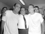 FILE - In this Jan. 14, 1968, file photo, Green Bay Pakers coach Vince Lombardi, center, embraces kicker Don Chandler, left, who kicked 4 field goals, and quarterback Bart Starr after winning football's Super Bowl II against the Oakland Raiders, in Miami. Starr, the Green Bay Packers quarterback and catalyst of Vince Lombardi's powerhouse teams of the 1960s, has died. He was 85. The Packers announced Sunday, May 26, 2019, that Starr had died, citing his family. He had been in failing health since suffering a serious stroke in 2014. (AP Photo, File)