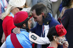John Velazquez is congratulated by Amr Zedan, Chairman & CEO at Zedan Group, after winning the 147th running of the Kentucky Derby onboard Medina Spirit at Churchill Downs, Saturday, May 1, 2021, in Louisville, Ky. (AP Photo/Jeff Roberson)