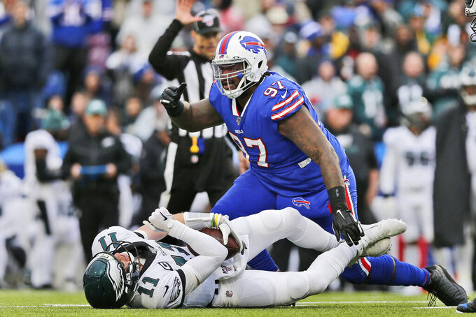 Buffalo Bills' Jordan Phillips, top, reacts after sacking Philadelphia Eagles quarterback Carson Wentz during the second half of an NFL football game, Sunday, Oct. 27, 2019, in Orchard Park, N.Y. (AP Photo/John Munson)