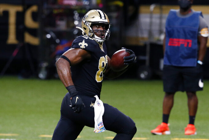 New Orleans Saints tight end Jared Cook (87) runs to the end zone on a touchdown reception in the second half of an NFL football game against the Los Angeles Chargers in New Orleans, Monday, Oct. 12, 2020. (AP Photo/Butch Dill)