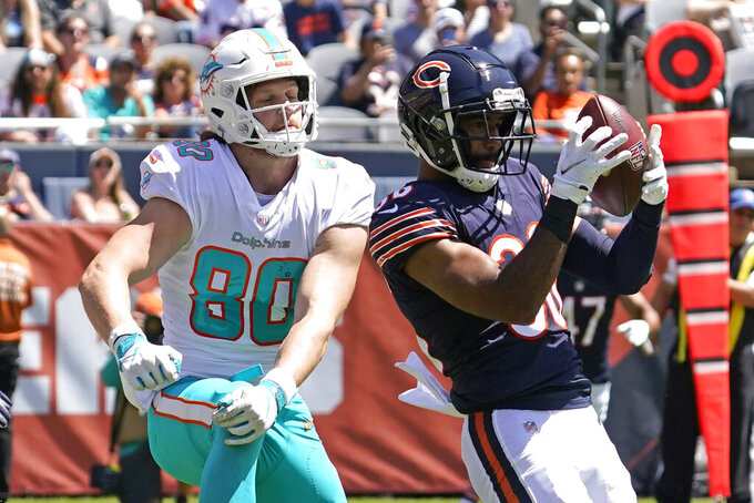 Chicago Bears defensive back DeAndre Houston-Carson, right, intercepts the ball against Miami Dolphins tight end Adam Shaheen during the first half of an NFL preseason football game in Chicago, Saturday, Aug. 14, 2021. (AP Photo/Nam Y. Huh)