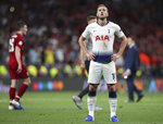 Tottenham's Harry Kane stands on the pitch after losing the Champions League final soccer match between Tottenham Hotspur and Liverpool at the Wanda Metropolitano Stadium in Madrid, Saturday, June 1, 2019. (AP Photo/Francisco Seco)