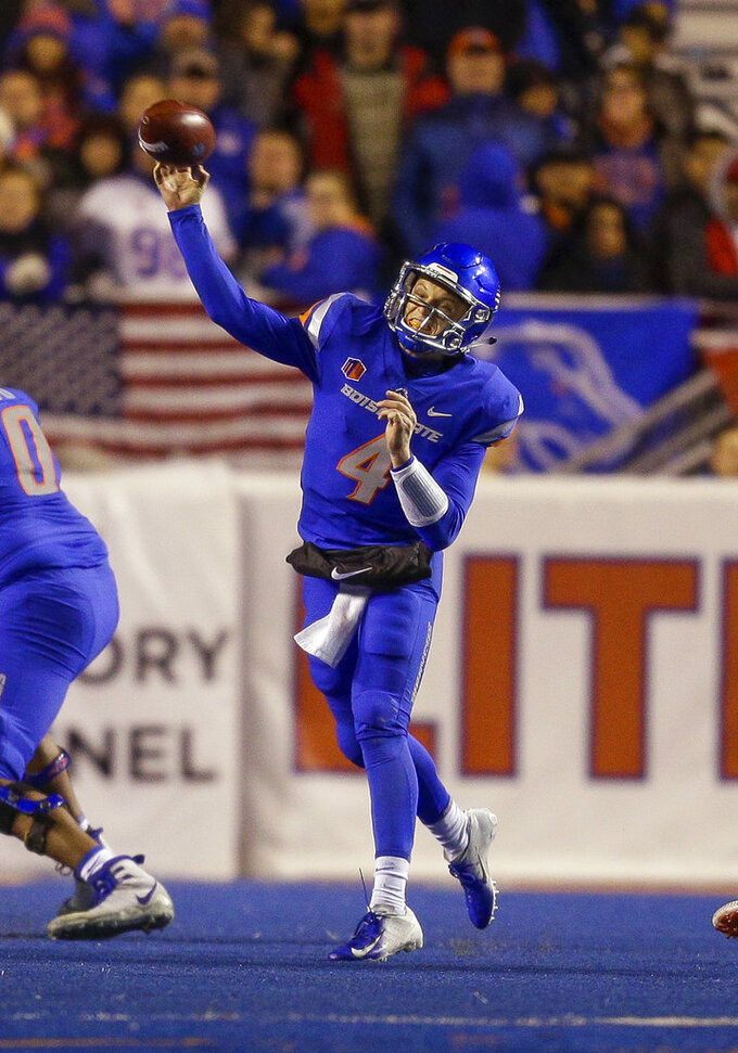 Boise State quarterback Brett Rypien (4) throws a pass against Fresno State during the first half of an NCAA college football game, Friday, Nov. 9, 2018, in Boise, Idaho. (AP Photo/Steve Conner)