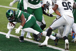New York Jets' Ty Johnson, left, scores a touchdown during the second half an NFL football game against the Las Vegas Raiders, Sunday, Dec. 6, 2020, in East Rutherford, N.J. (AP Photo/Noah K. Murray)