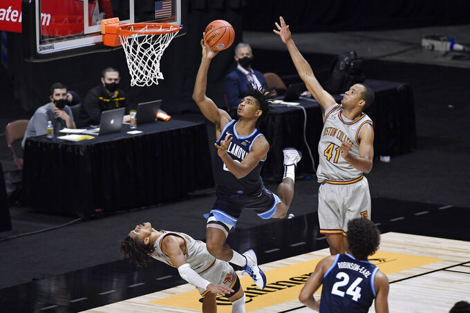 Boston College's Makai Ashton-Langford, bottom left, fouls Villanova's Jermaine Samuels during the second half of an NCAA college basketball game Wednesday, Nov. 25, 2020, in Uncasville, Conn. (AP Photo/Jessica Hill)