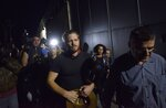 Jock Palfreeman leaves a migrants' detention centre in Busmantsi, Bulgaria, Tuesday, Oct. 15, 2019. Australian man Palfreeman was convicted of fatally stabbing a Bulgarian student during a 2007 brawl and has been paroled after serving 11-years of his 20-year prison sentence, but then held back in a detention centre after a prosecutors' petition to revoke the parole. (AP Photo)