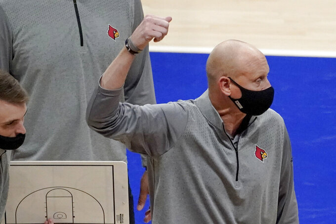 Louisville coach Chris Mack gestures as he talks to the team during a timeout in the second half of the team's NCAA college basketball game against Pittsburgh, Tuesday, Dec. 22, 2020, in Pittsburgh. (AP Photo/Keith Srakocic)