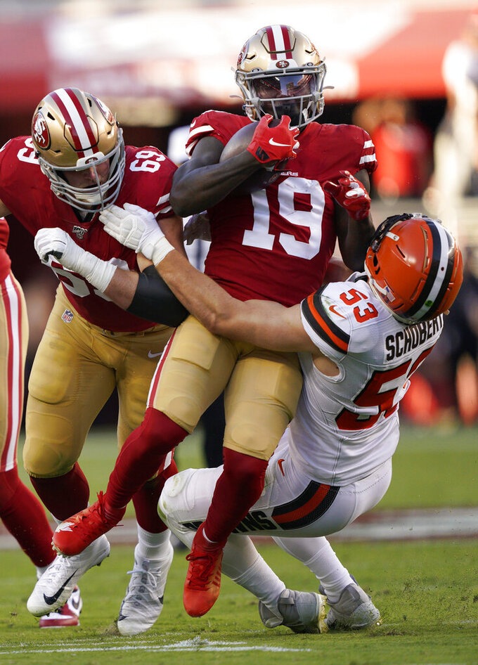 San Francisco 49ers wide receiver Deebo Samuel (19) is tackled by Cleveland Browns middle linebacker Joe Schobert (53) during the first half of an NFL football game in Santa Clara, Calif., Monday, Oct. 7, 2019. At left is 49ers offensive tackle Mike McGlinchey. (AP Photo/Tony Avelar)