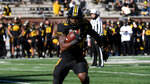 Missouri running back Larry Rountree III scores on a touchdown run during the first half of an NCAA college football game against Arkansas, Saturday, Dec. 5, 2020, in Columbia, Mo. (AP Photo/L.G. Patterson)
