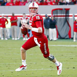 North Carolina State's Ryan Finley (15) rolls out to pass during the first half of an NCAA college football game against Florida Statein Raleigh, N.C., Saturday, Nov. 3, 2018. (AP Photo/Chris Seward)
