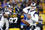 Los Angeles Rams quarterback Jared Goff (16) looks to throw a pass under pressure from Pittsburgh Steelers defensive end Cameron Heyward (97) during the first half of an NFL football game against the Pittsburgh Steelers in Pittsburgh, Sunday, Nov. 10, 2019. (AP Photo/Keith Srakocic)