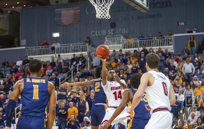 Belmont's Nick Hopkins (14) shoots against Murray State during the first half of an NCAA college basketball game for the championship of the Ohio Valley Conference men's tournament Saturday, March 7, 2020, in Evansville, Ind. (AP Photo/Daniel R. Patmore)