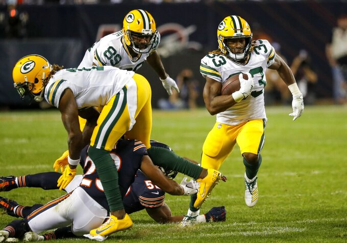 Green Bay Packers' Aaron Jones runs during the second half of an NFL football game against the Chicago Bears Thursday, Sept. 5, 2019, in Chicago. (AP Photo/Charles Rex Arbogast)
