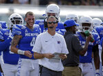 "FILE - In this Dec. 2, 2017, file photo, Memphis coach Mike Norvell looks up at the scoreboard during a timeout in the first half of the American Athletic Conference championship NCAA college football game against Central Florida in Orlando, Fla. Memphis has been waiting for a chance for payback since that conference championship for another opportunity at UCF, and that comes Saturday in a big showdown. The 10th-ranked Knights haven't missed a step and come in with the nation's longest winning streak at 18 straight. ""They are yet to have a setback,"" Norvell said. ""They are a dominant team. They have been dominant against every opponent they've played."" (AP Photo/John Raoux, File)"