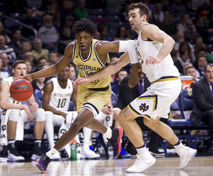 Georgia Tech's Khalid Moore, left, drives by Notre Dame's John Mooney during the first half of an NCAA college basketball game Sunday, Feb. 10, 2019, in South Bend, Ind. (AP Photo/Robert Franklin)