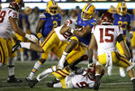 Southern California's Kana'i Mauga (26) tackles California's Christopher Brown Jr. during the first quarter of an NCAA college football game Saturday, Nov. 16, 2019, in Berkeley, Calif. (AP Photo/Ben Margot)