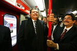 FILE - In this July 11, 2011 file photo, Peru's outgoing President Alan García, left center, rides the new Line 1 electrical train system, in Lima, Peru.  Current Peruvian President Martinez Vizcarra said Garcia, the 69-year-old former head of state died Wednesday, April 17, 2019, after undergoing emergency surgery in Lima. Garcia shot himself in the head early Wednesday as police came to detain him in connection with a corruption probe.  (AP Photo/Martin Mejia, File)
