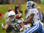 Northwestern's Riley Lees, left, is guarded by Duke's Leonard Johnson during the second half of an NCAA college football game Saturday, Sept. 8, 2018, in Evanston, Ill. (AP Photo/Jim Young)